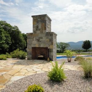 Poolside fireplace patio Vermont Carpenter Costin