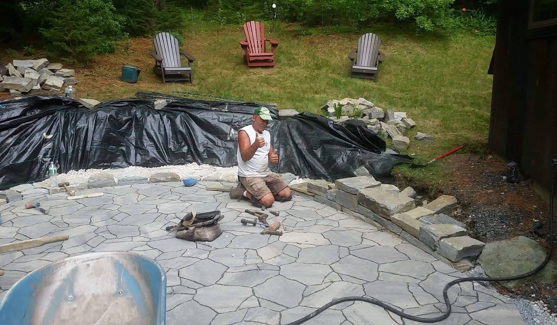 Man installing patio by Carpenter & Costin