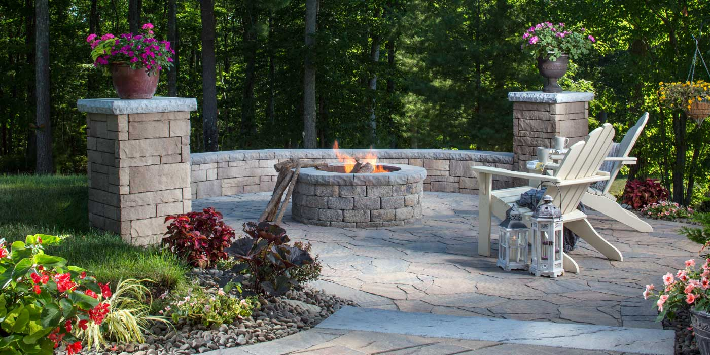 Outdoor stone fireplace gathering spot