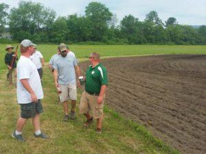 Men after tilling the soil for planting