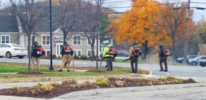 men running leaf blowers