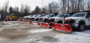 Fleet of snowplow trucks