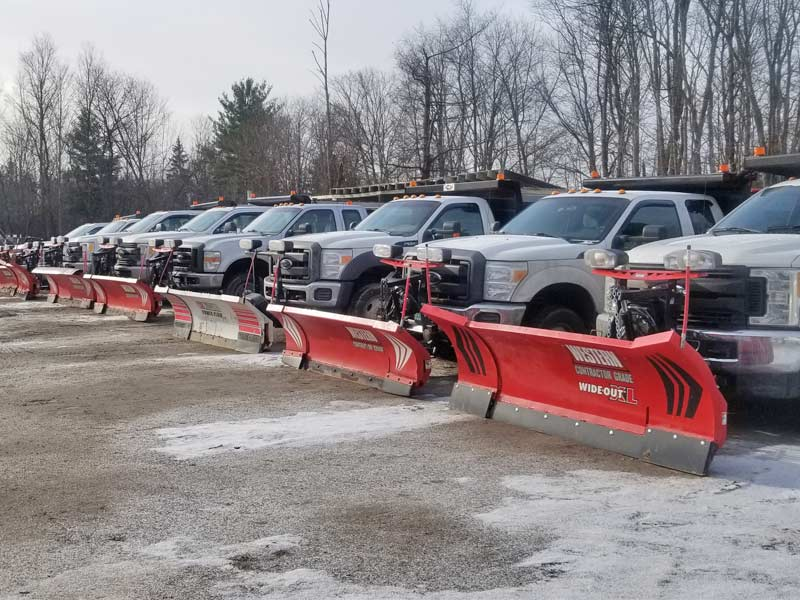 Commercial fleet of snow plow trucks