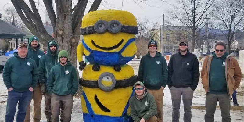 snow sculpture of Minions by Team Carpenter & Costin