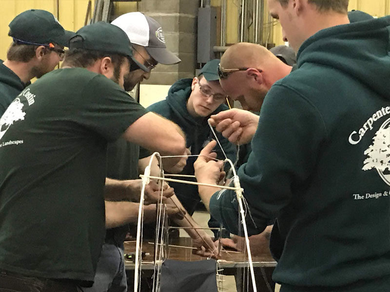 People building a model bridge