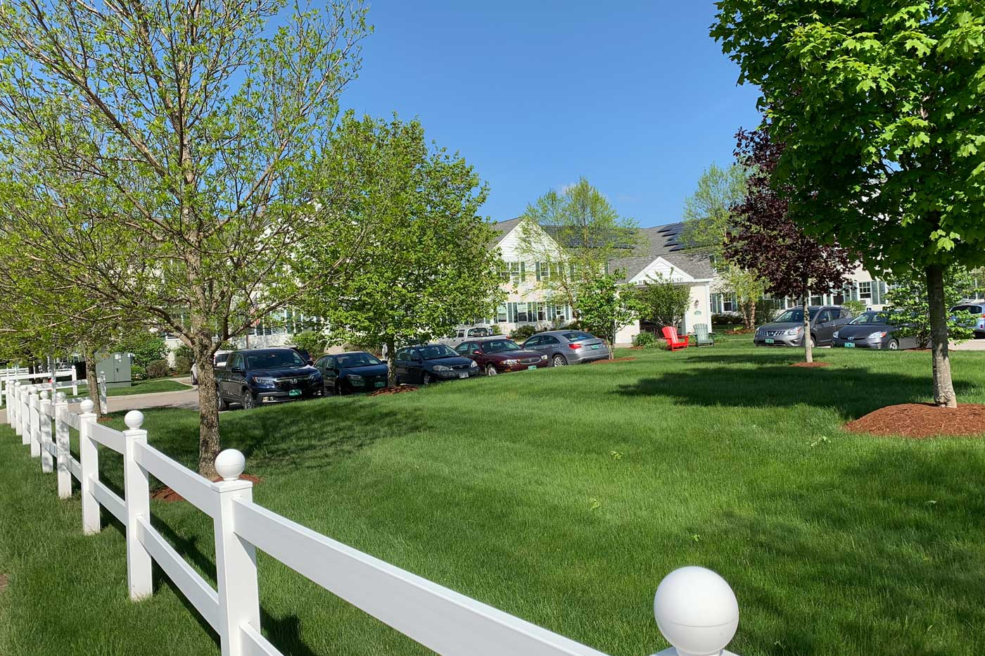 Lawn with white fence at assisted living facility